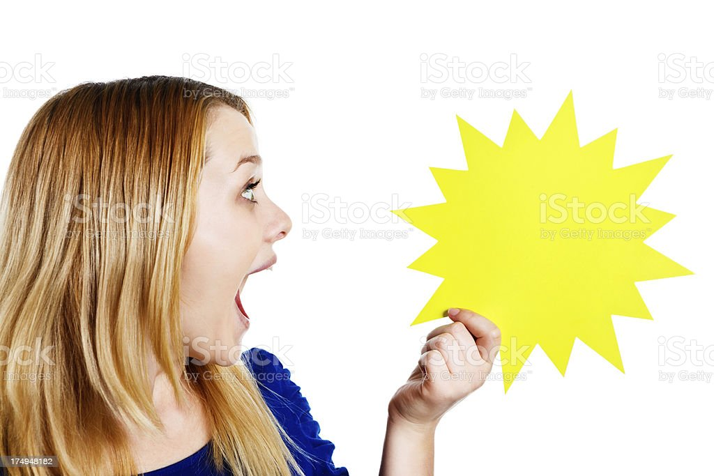 Delighted blonde teenager smiles at star, blank for your message royalty-free stock photo