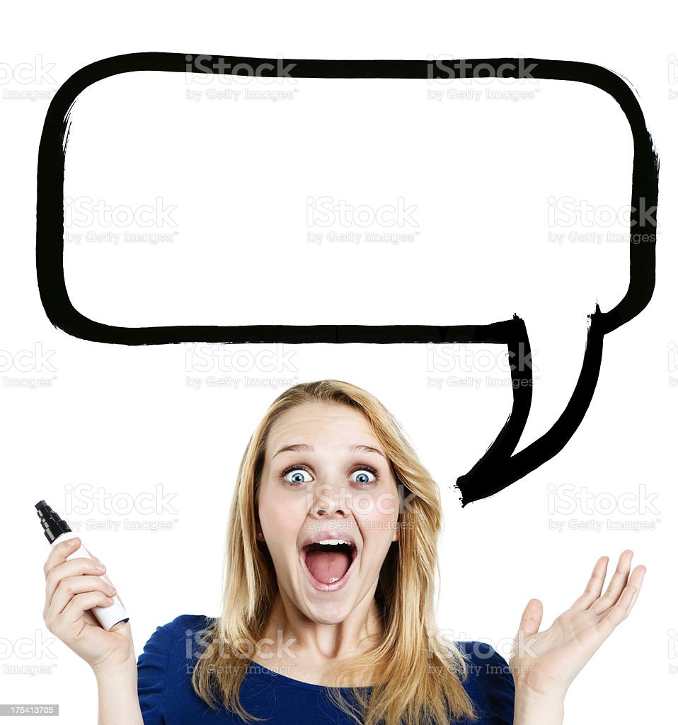 Delighted blonde teenager with blank speech bubble for your message stock photo