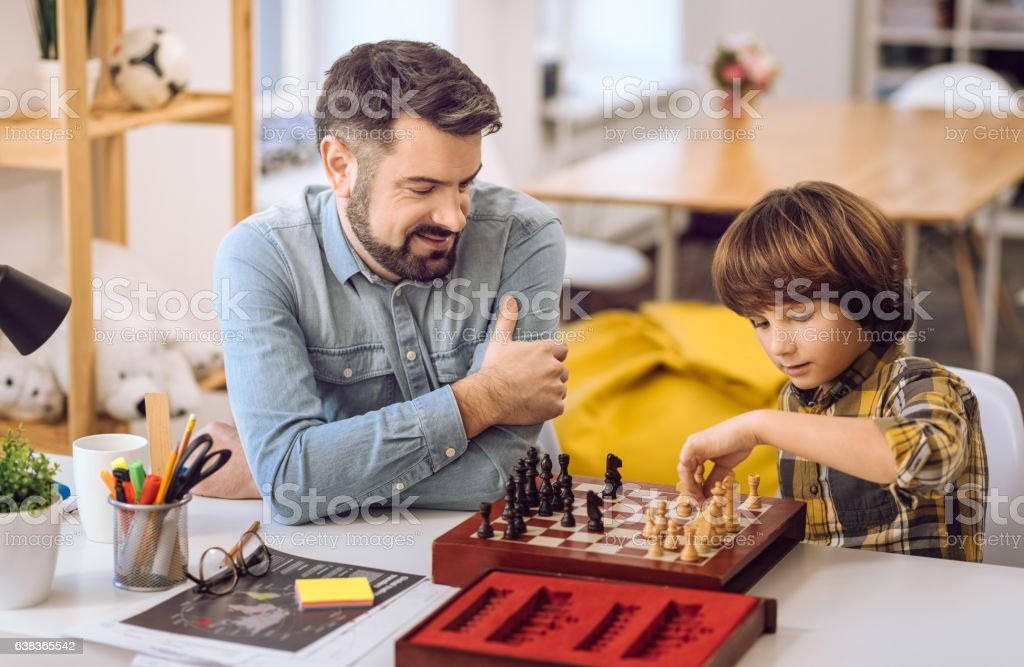 Delighted boy and his uncle posing in semi position stock photo