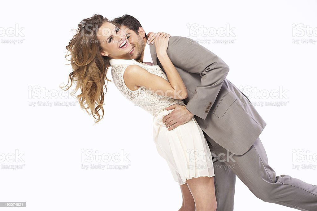 Delighted couple hugging each other stock photo