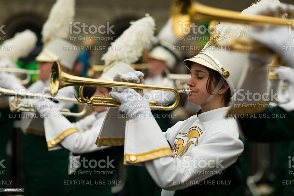 Delighted female trumpet player with closed eyes stock photo
