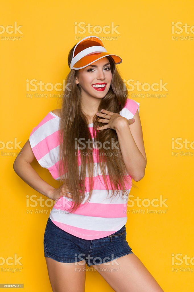 Delighted Girl WIth Hand On Chest stock photo