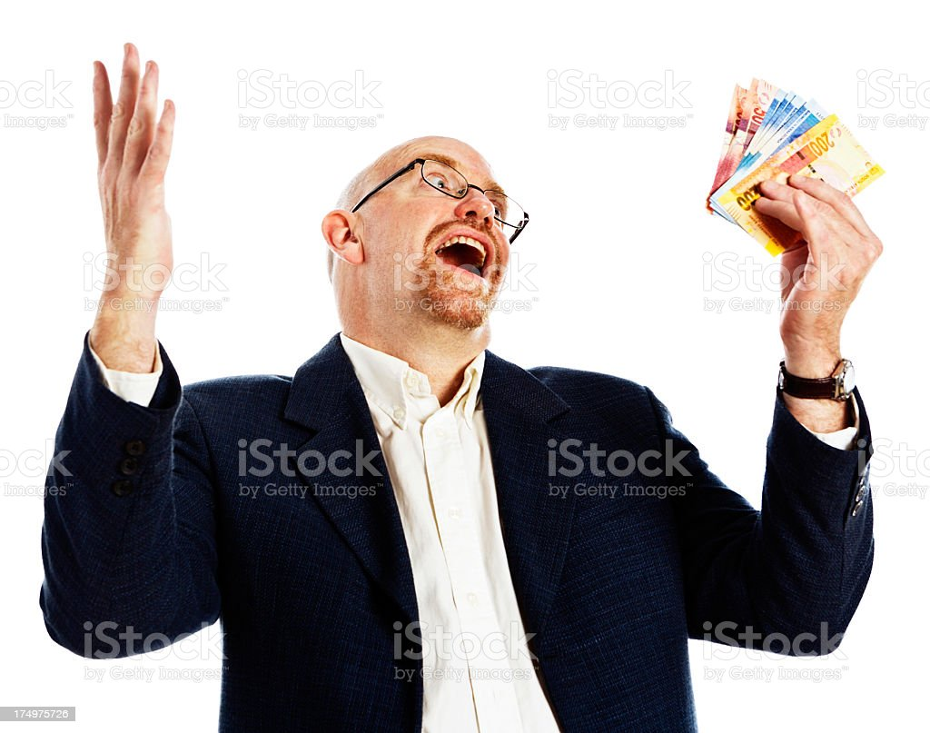 Delighted man smiles, gesturing at sheaf of banknotes he holds stock photo