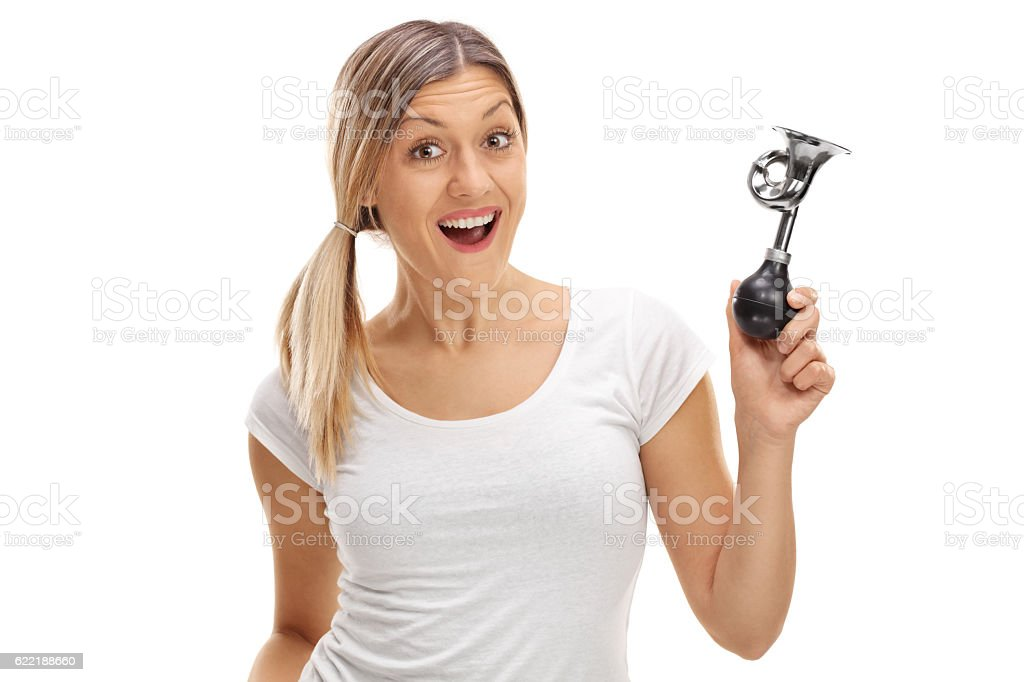 Delighted woman holding a horn stock photo