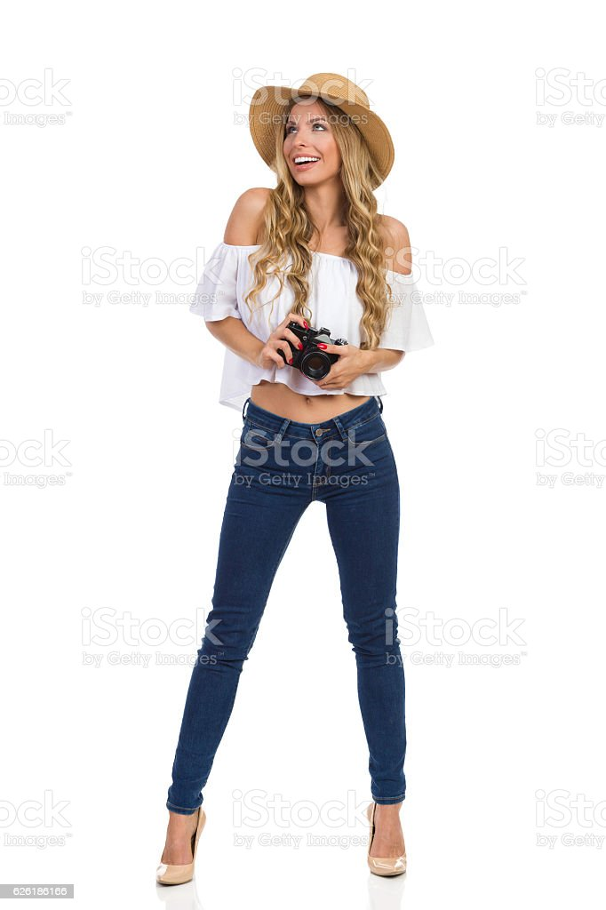 Delighted Woman In Straw Hat Holding A Camera stock photo