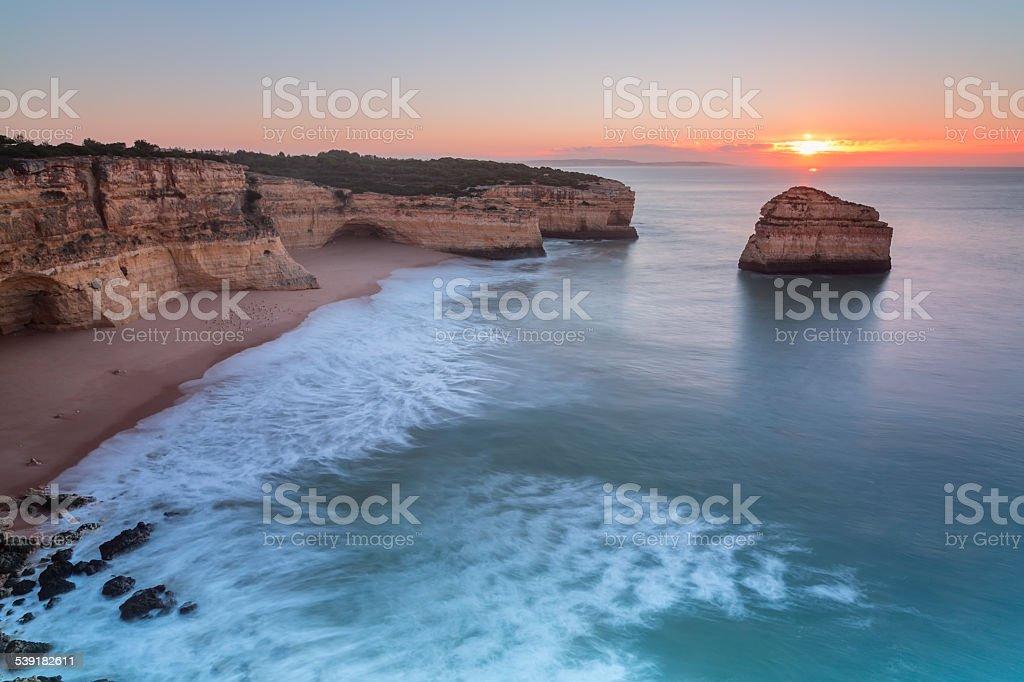 Delightful sunrise on the beach. In Albufeira. stock photo