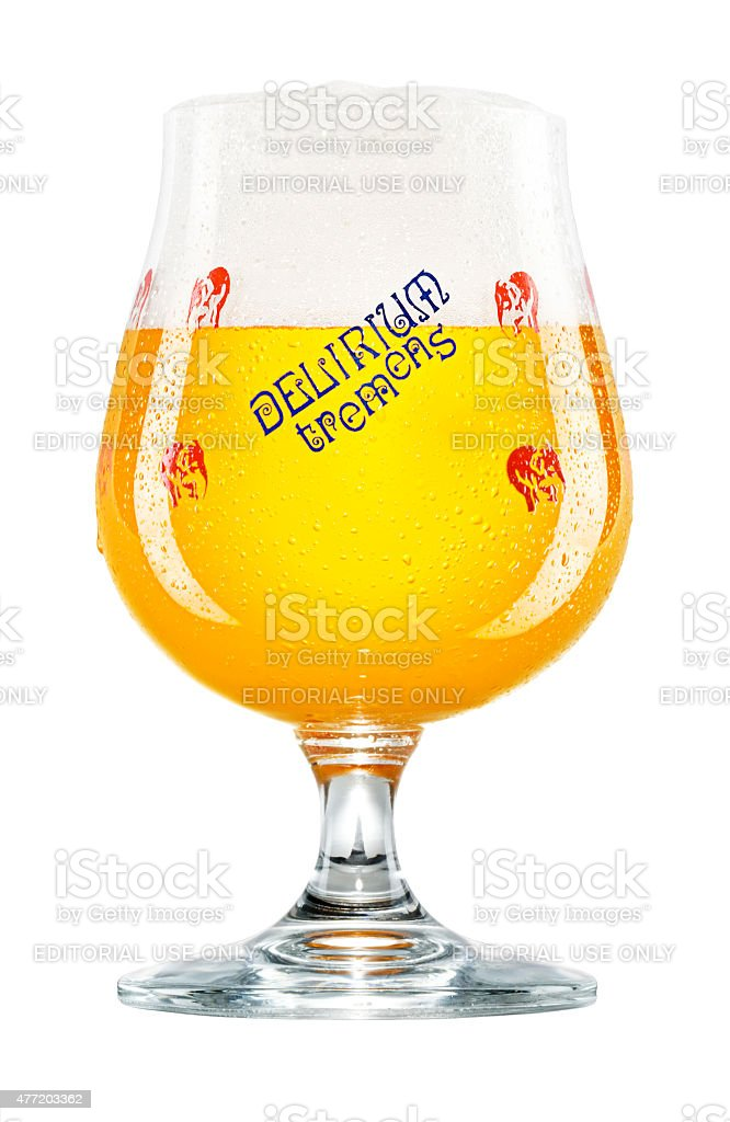 Delirium Tremens Belgian Beer in Glass on White Background stock photo