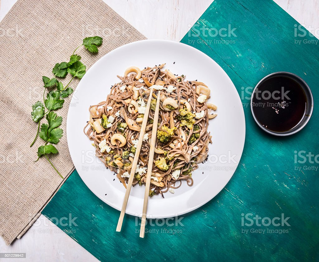 delisious Japanese buckwheat noodles squid and oyster mushrooms  rustic background stock photo
