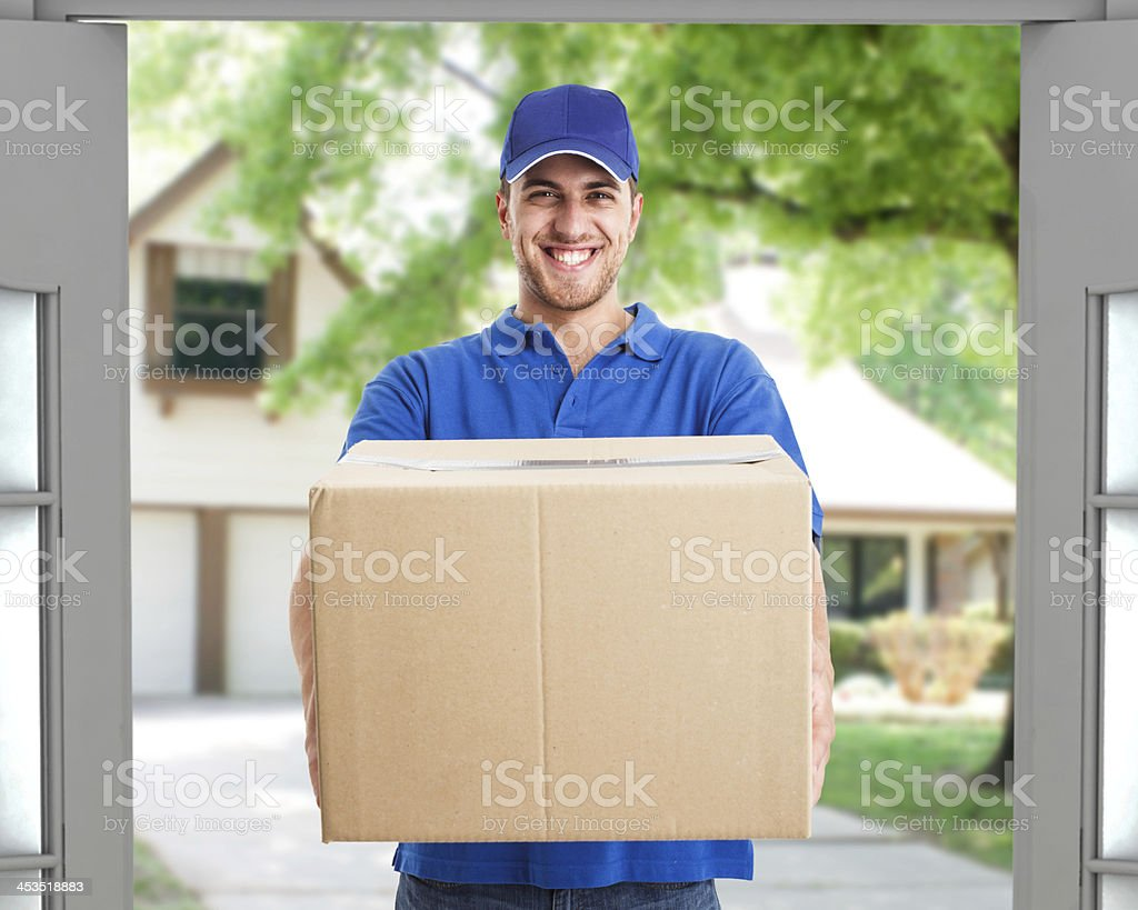Deliverer holding a box stock photo
