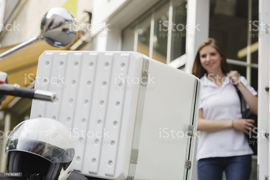 Delivering fast food on Motor scooter royalty-free stock photo
