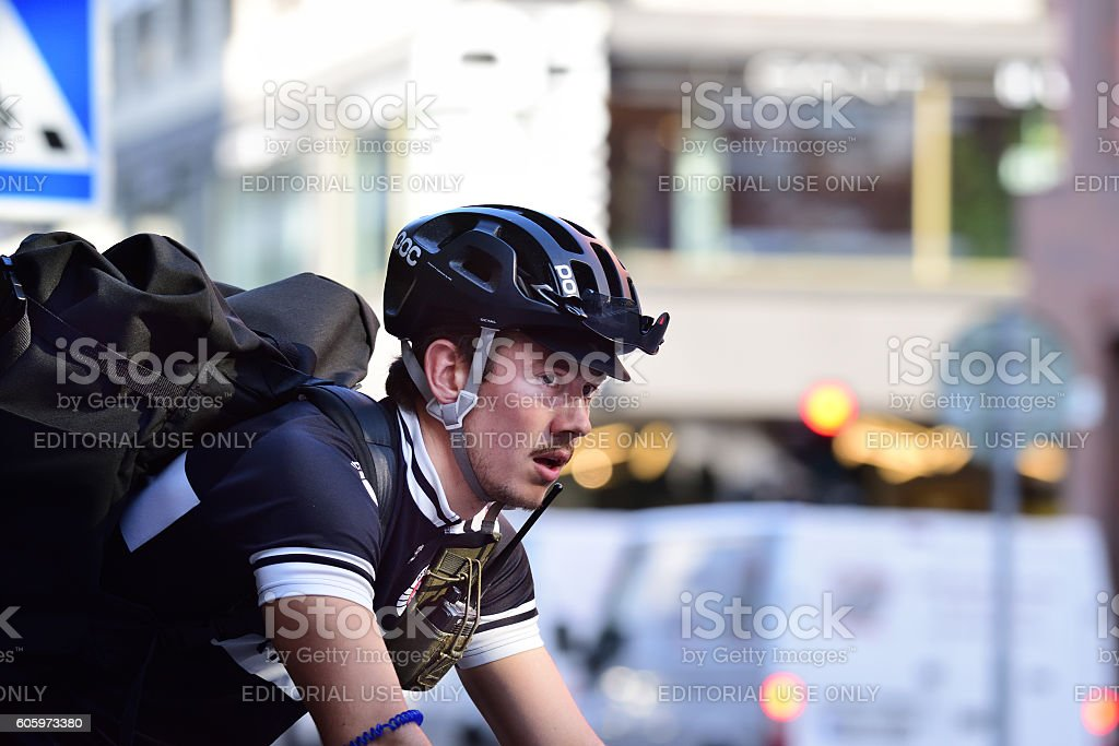 Delivery bike in action, courier for Ryska Posten company stock photo
