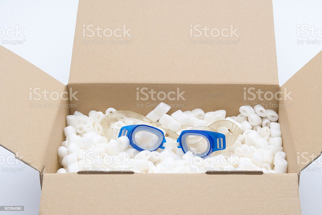 Delivery Box with Blue Swimming Goggles royalty-free stock photo