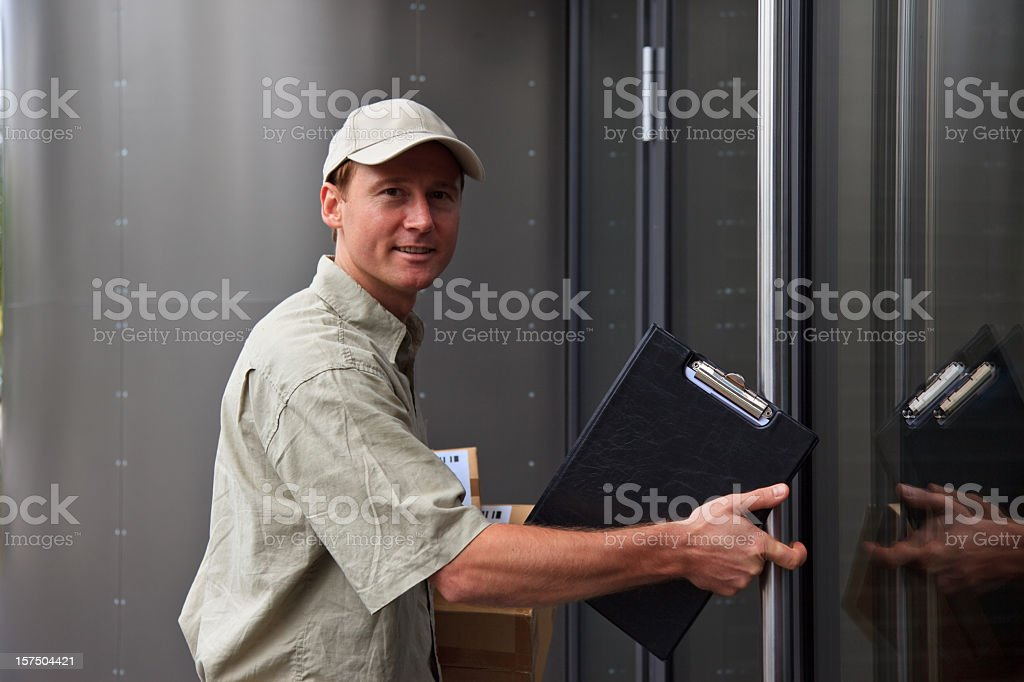 delivery boy at your door royalty-free stock photo