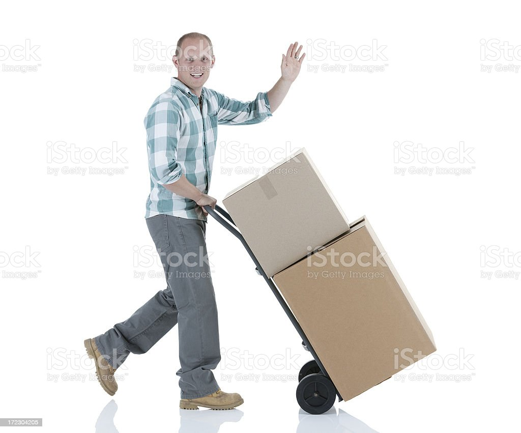 Delivery boy carrying cardboard boxes royalty-free stock photo