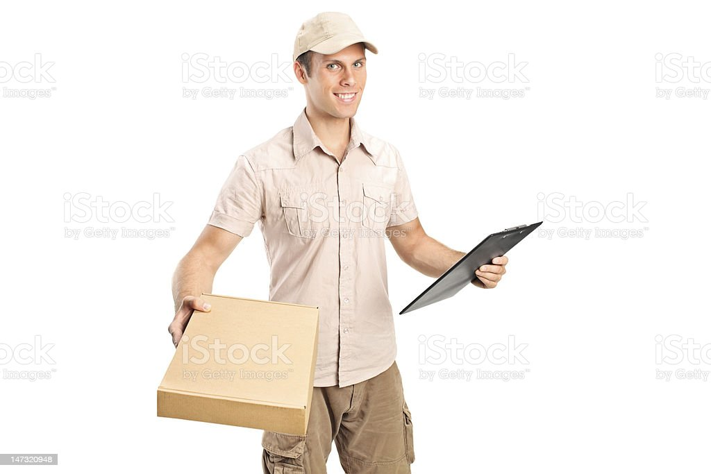 Delivery boy delivering a packet and holding clipboard stock photo