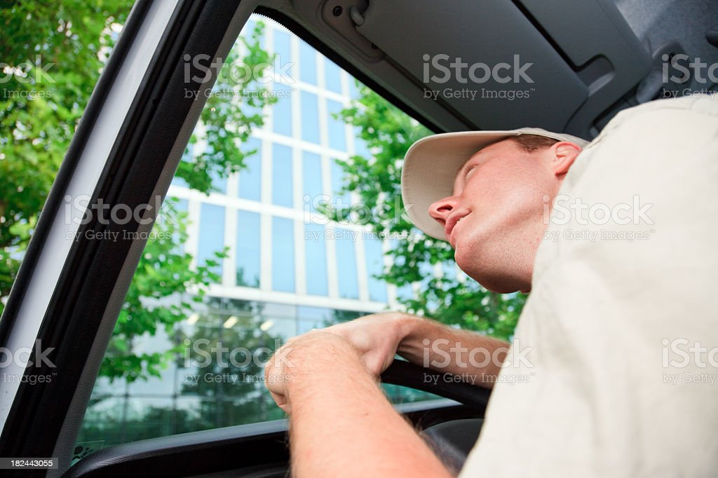 delivery boy driving a van royalty-free stock photo