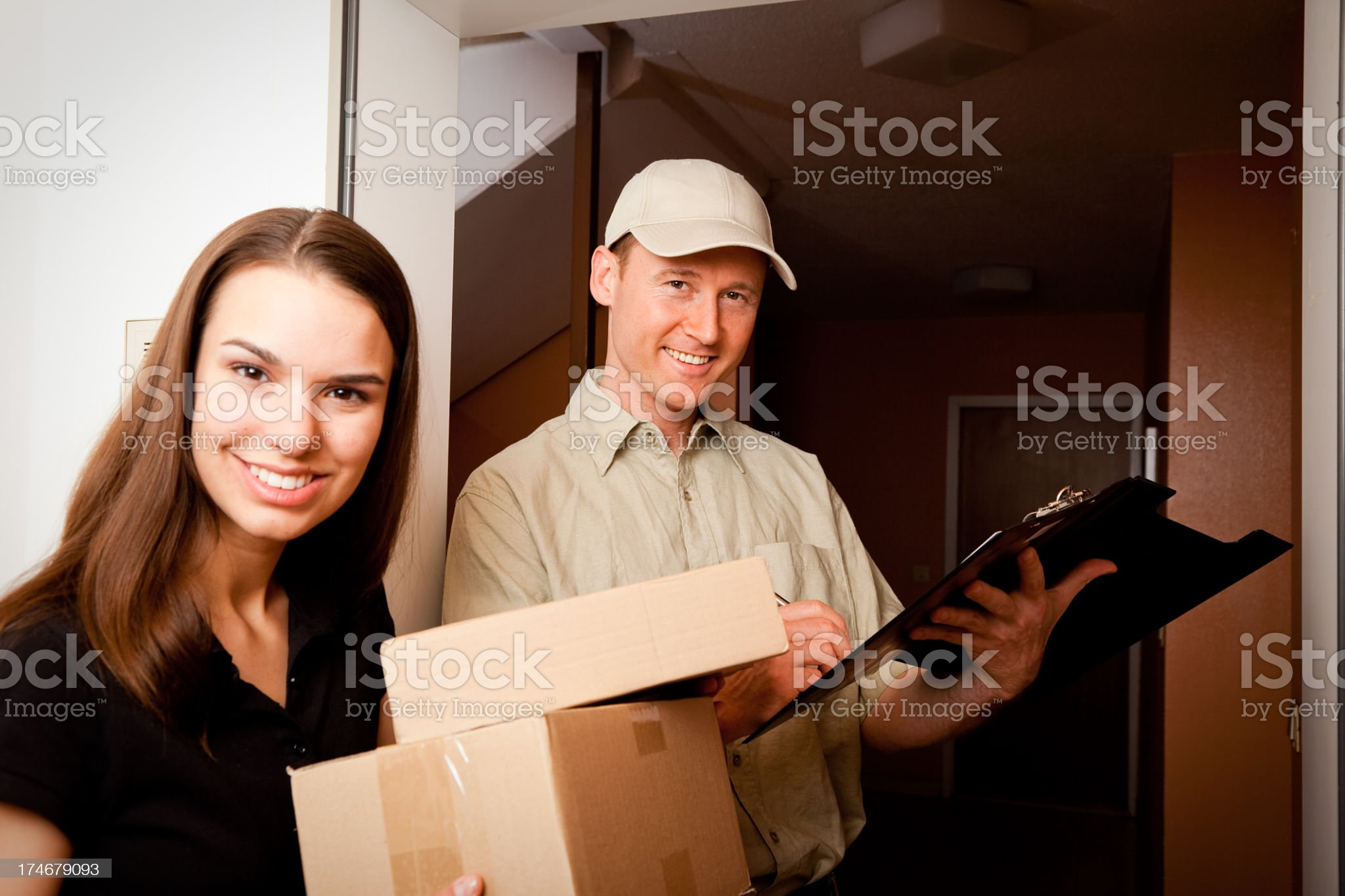 delivery boy handing over some packets royalty-free stock photo