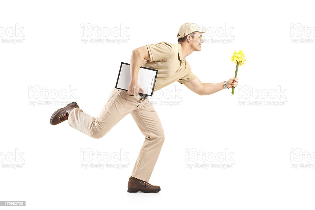 Delivery boy in a rush delivering flowers royalty-free stock photo