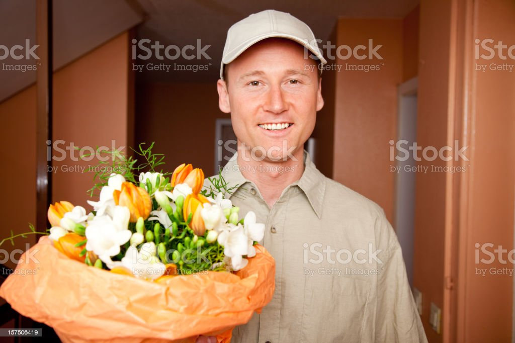 delivery boy with flowers at your door royalty-free stock photo