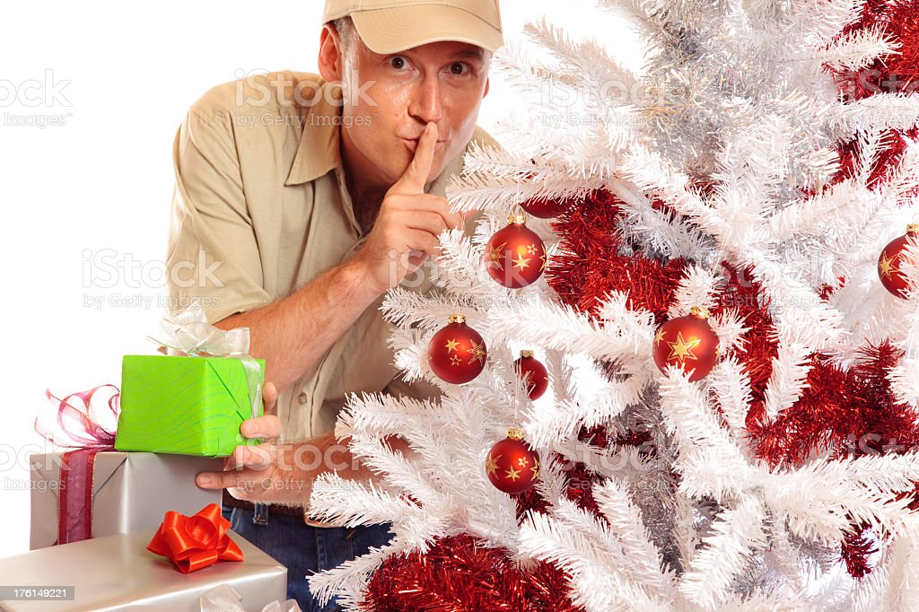 delivery boy with gifts and christmas tree stock photo