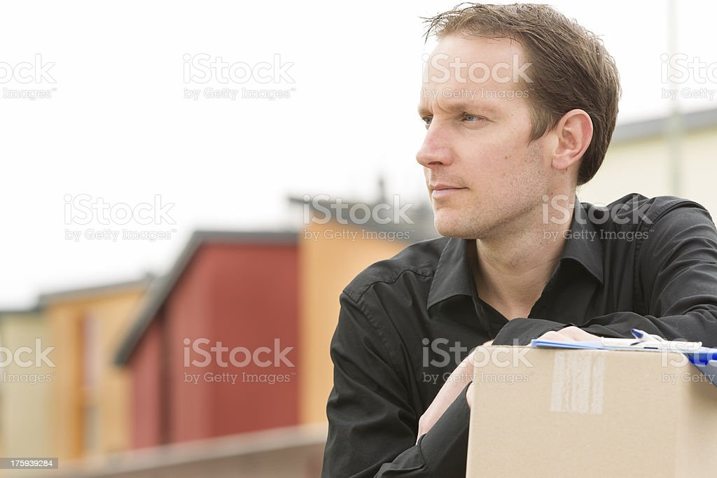 Delivery courier delivering package royalty-free stock photo