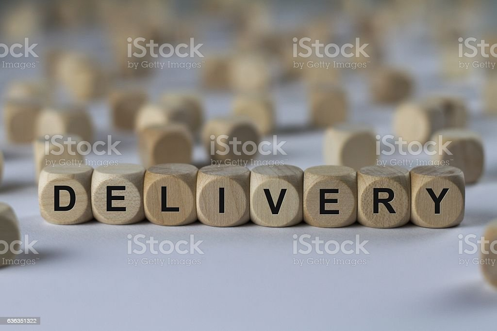 delivery - cube with letters, sign with wooden cubes stock photo