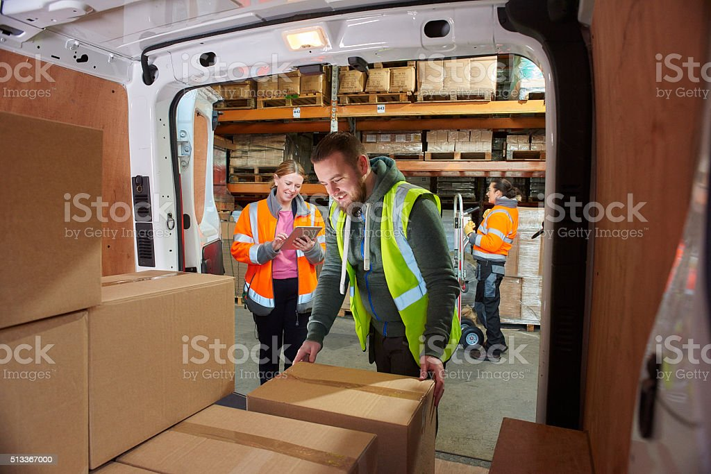 delivery driver in the warehouse stock photo