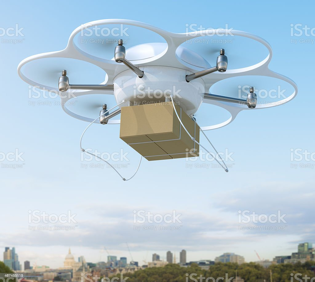 Delivery drone carrying package on a city stock photo