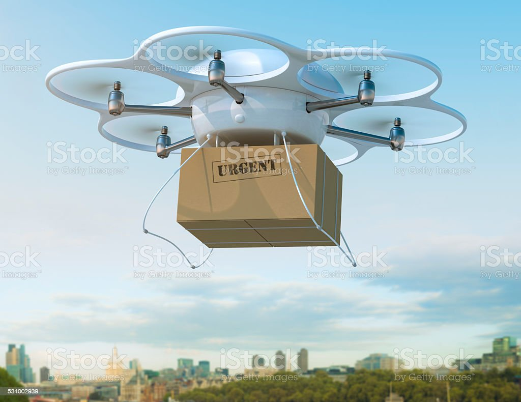 Delivery drone carrying urgent shipment box in a city. stock photo