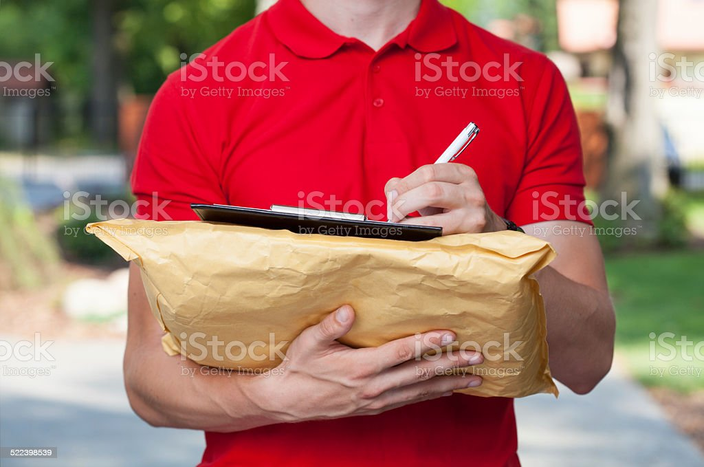 Delivery guy does his paperwork stock photo
