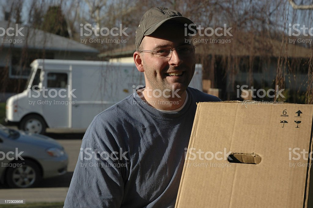 Delivery Man Bringing a Package royalty-free stock photo