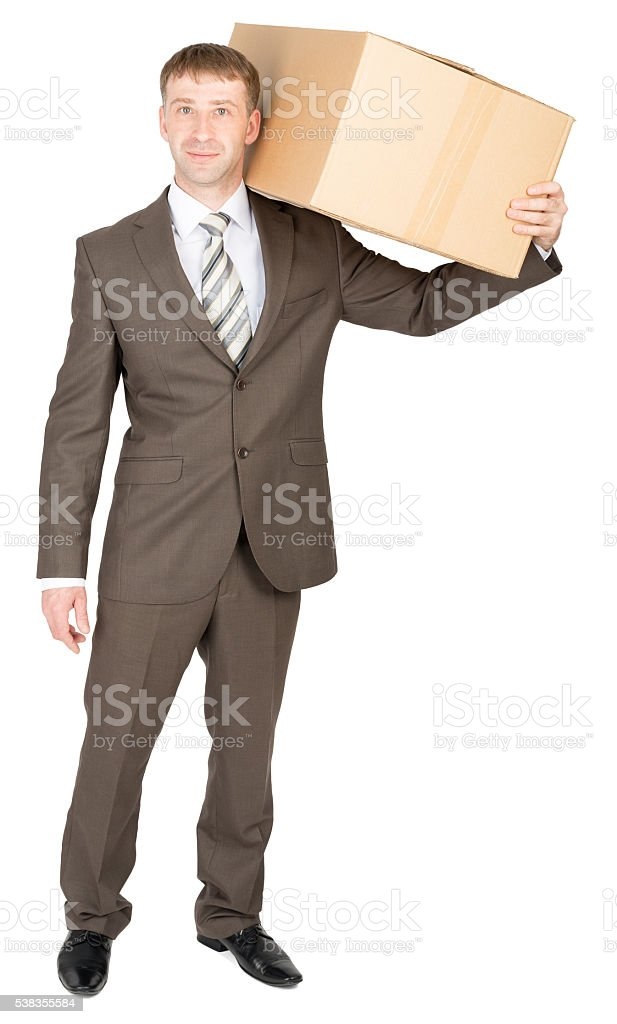 Delivery man carrying box over shoulder stock photo