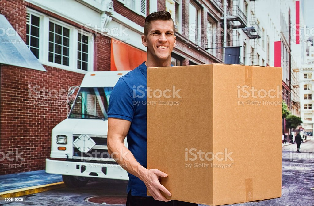 Delivery man carrying cardboard box stock photo