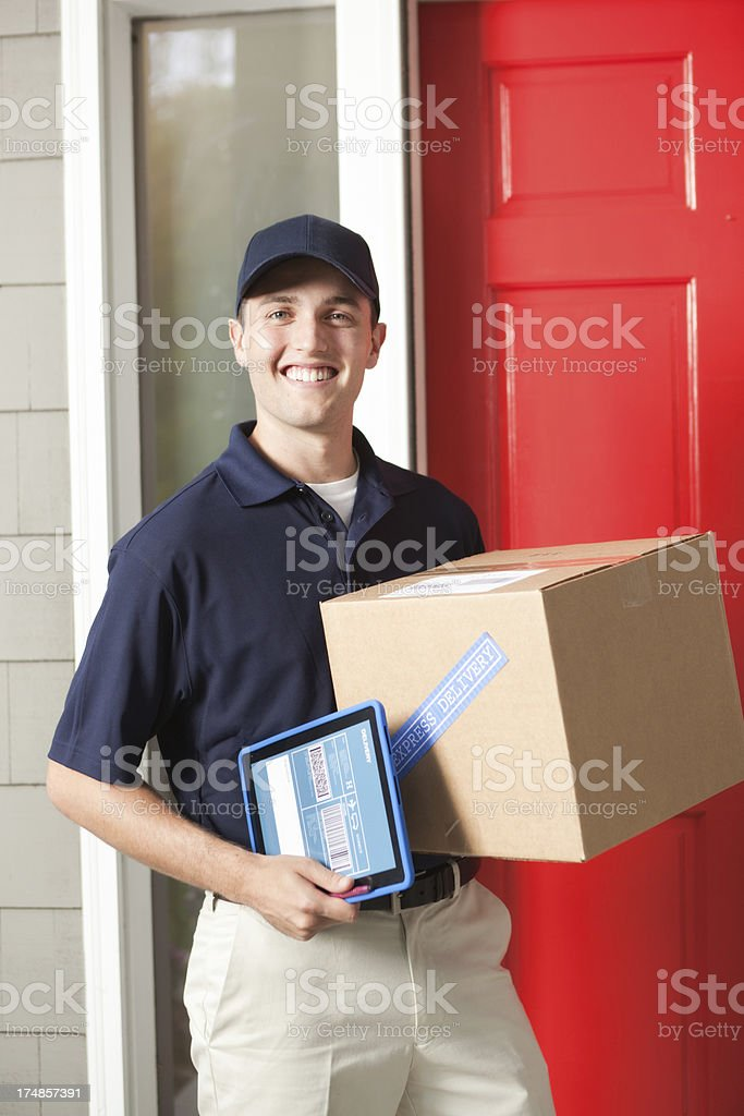 Delivery Man Delivering Package in Front of Customer's Door Vt royalty-free stock photo