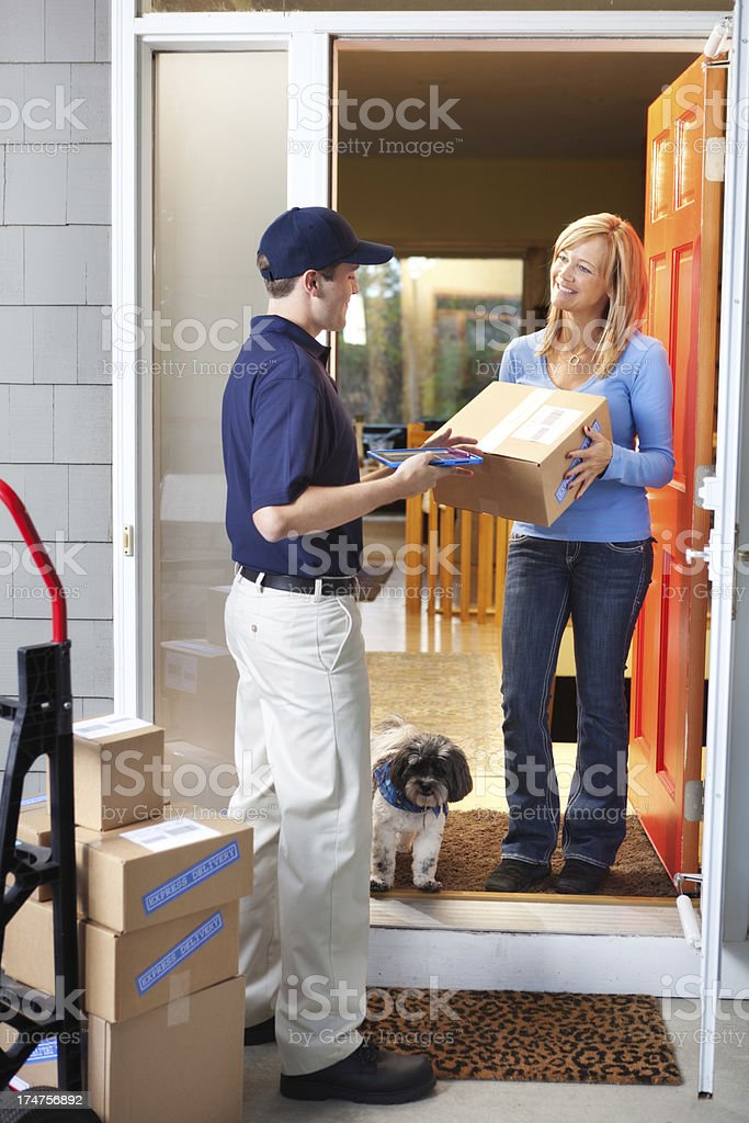 Delivery Man Deliverying Packages to Customer's Home Vt royalty-free stock photo
