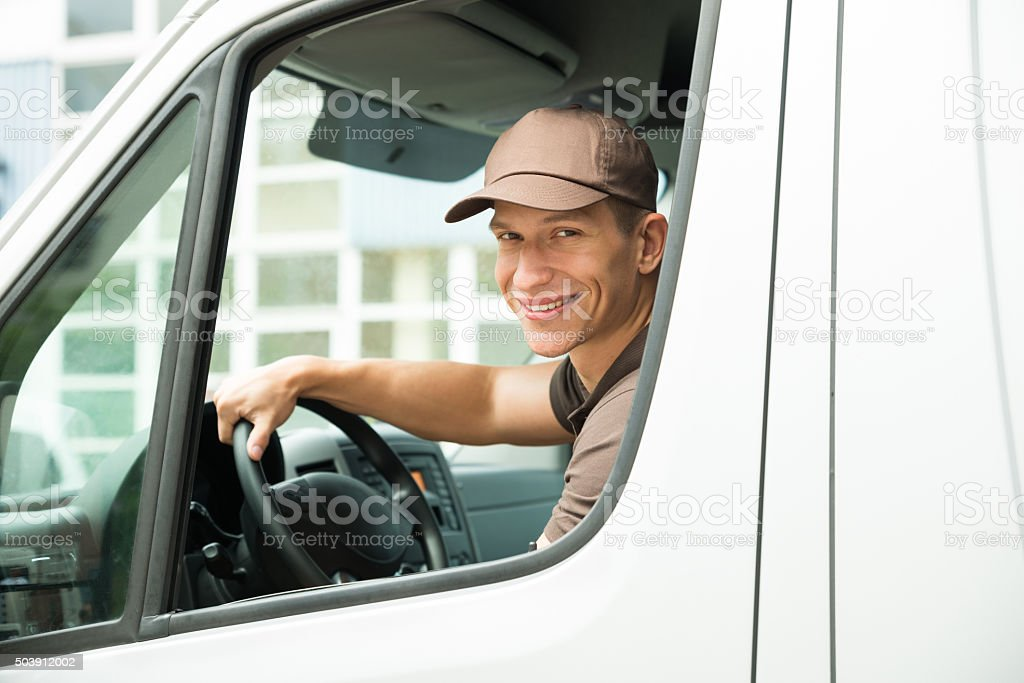 Delivery Man Driving Van stock photo