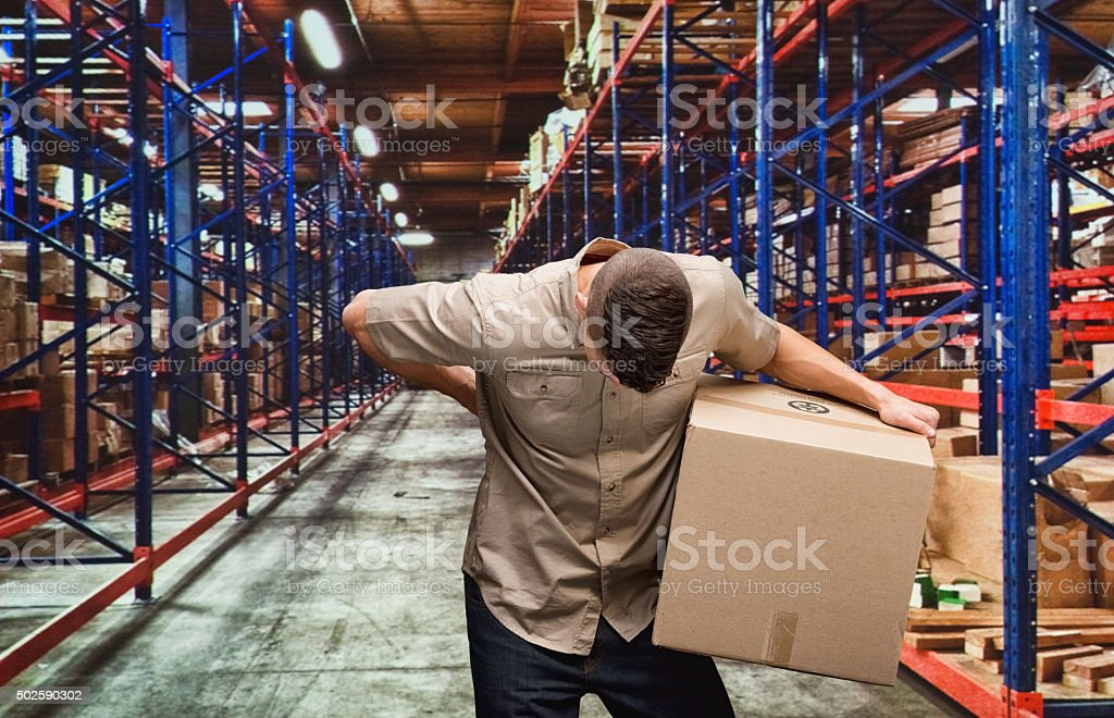 Delivery man having backache stock photo