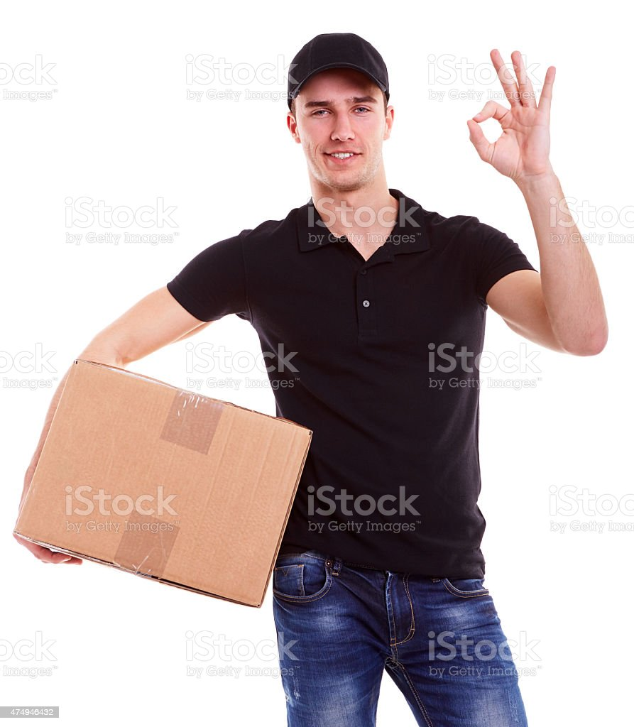 Delivery man holding a cardboard box stock photo
