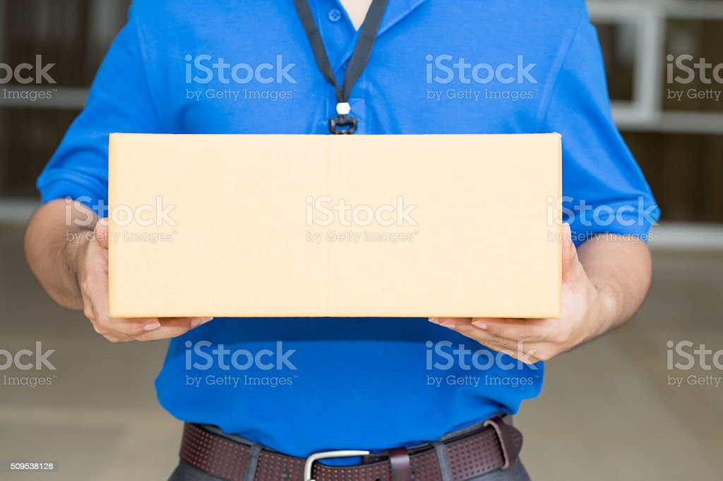 Delivery man holding a parcel box stock photo