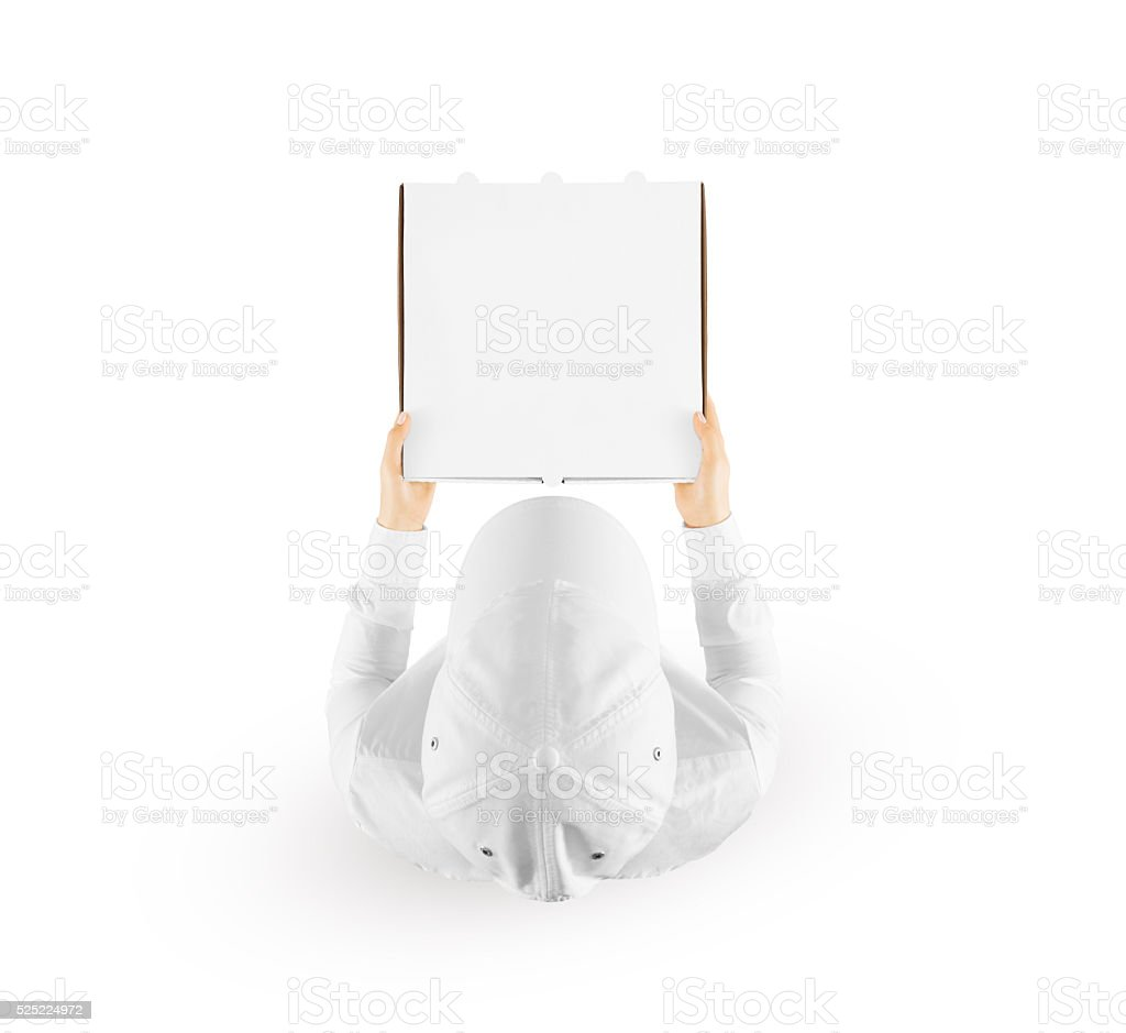 Delivery man holding blank pizza box mockup hand, top view stock photo