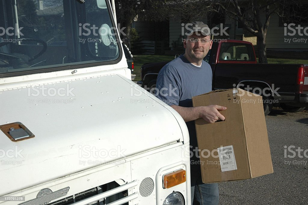Delivery Man in Suburban Neighborhood royalty-free stock photo