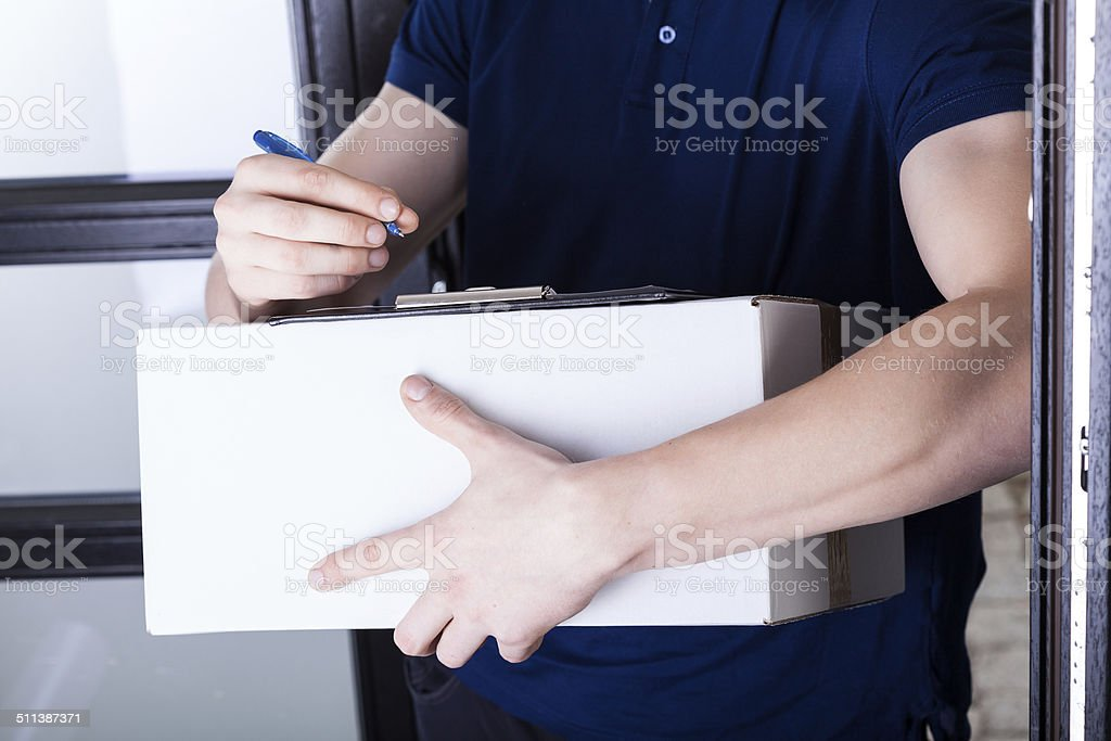 Delivery man supplying pack stock photo