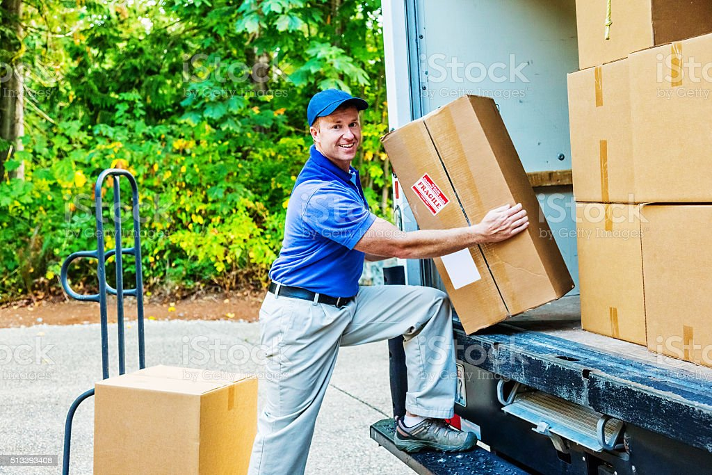 Delivery Man Unloading His Truck stock photo