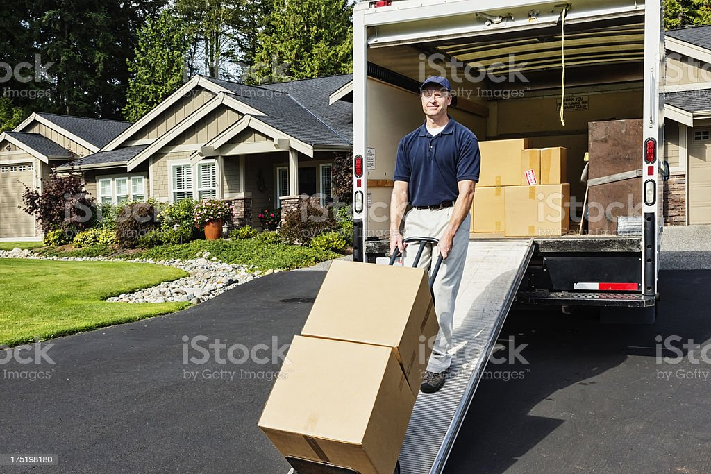 Delivery Man Unloading Truck stock photo
