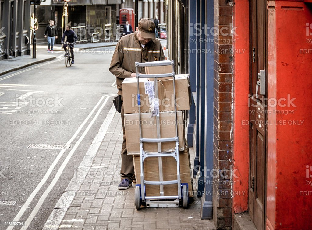 Delivery man with boxes in urban setting stock photo