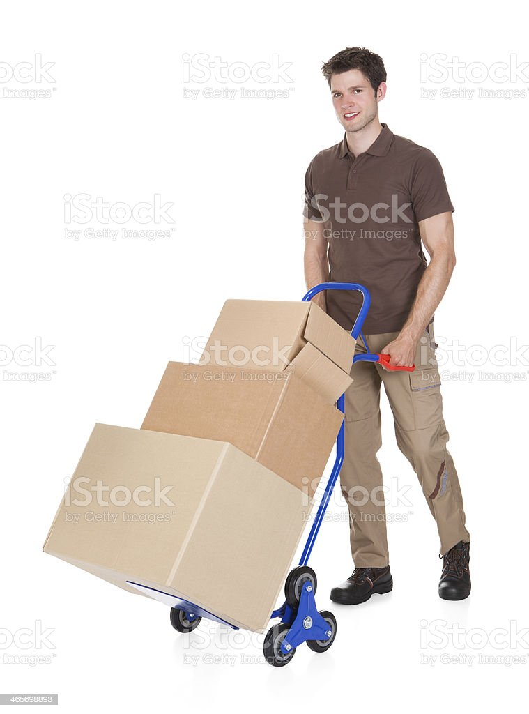 Delivery Man With Hand Truck And Boxes stock photo