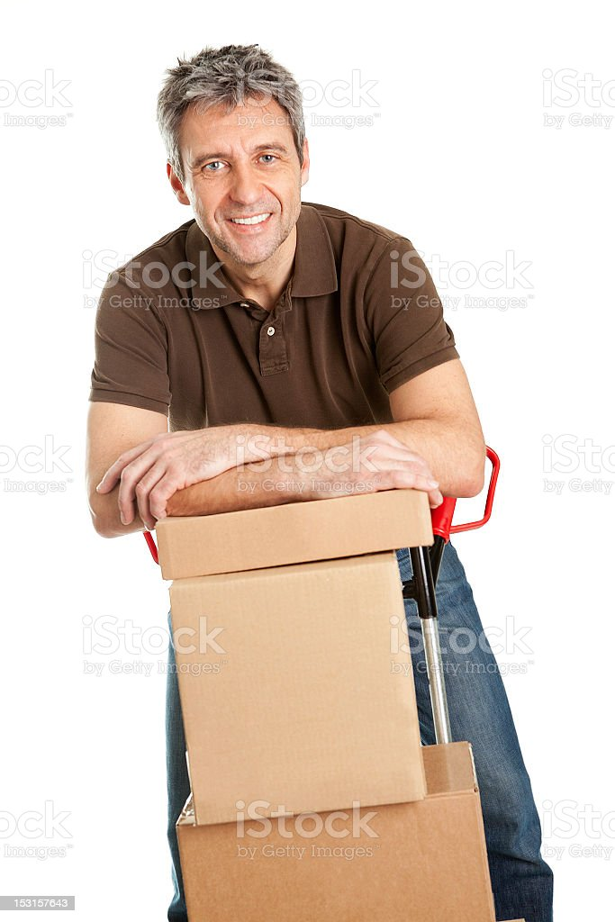 Delivery man with hand truck and stack of boxes royalty-free stock photo