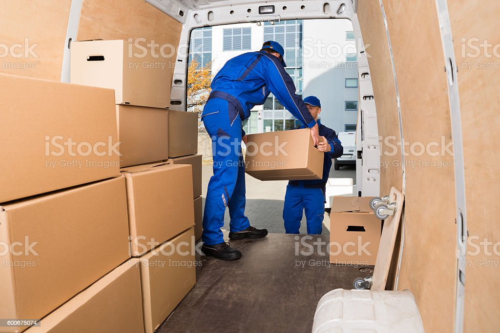 Delivery Men Loading Cardboard Boxes stock photo