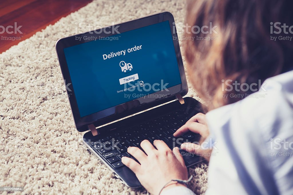 Delivery order message on a laptop screen. stock photo