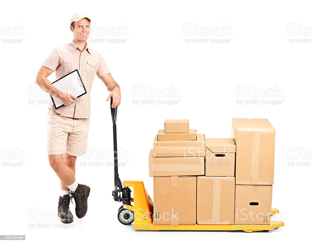 Delivery person and a fork pallet truck stacker royalty-free stock photo